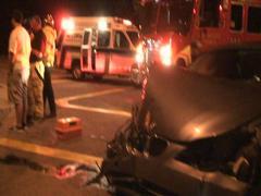 Bad car accident drunk driving crash 911 emergency crash totaled flashing lights Stock Footage
