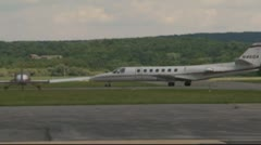 Private jets and small jets on runway and parked Stock Footage