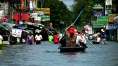 Thai People Navigate The Streets Of Bangkok In Boats During Floods Stock Footage