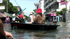 Three Thai Women In A Boat During the Floods Of Bangkok, Thailand Stock Footage