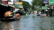 Stock Video Footage of People Pass Each Other In Boats On Flooded Streets In Bangkok