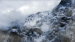 Snow Clouds and Foggy Snowy Mountains Stock Footage