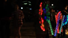 Colorful lighting pinwheel spinning on street Stock Footage