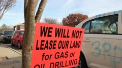 Non supportive sign referring to gas or oil drilling - stock footage