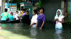 Thai People Standing in Flood Waters Stock Footage