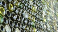 Stock Video Footage of Sonoma wine bottle wall - wide shot - 1080p HD