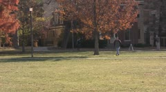 Stock Footage College Students in Fall - med Wide, several students, trees Stock Footage