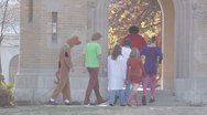 Stock Footage - Costume - Group Dressed as complete Scooby Doo cast walking Stock Footage