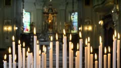 Candles and altar in church, Italy Stock Footage