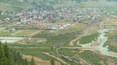 A very distant shot of a steam train arriving in Silverton, Colorado. Stock Footage