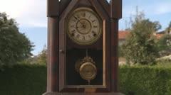 Clock pendulum in garden time concept Stock Footage