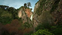 The green and rocky setting of Iyon Tanur waterfall in Israel. Stock Footage
