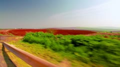 Drive-by of a furrowed field in Israel. Stock Footage