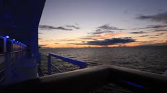 Evening sky in the ocean from the deck of the ship Stock Footage