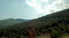 Drive-by of a forested mountainside in Israel. Stock Footage