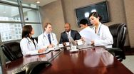 Stock Video Footage of Medical Executive Boardroom Meeting with Financial Advisors