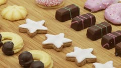 Loop of christmas cookies on wooden board Stock Footage