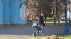 Russian Orthodox Church. The park is a man with a baby in a stroller. Stock Footage