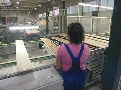 Worker supervising production process of parquet boards.   Stock Footage