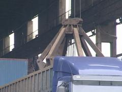 Stock Video Footage of Special crane unloading metal from truck. Cargo industry.