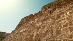 Drive-by of rocky desert landscape in Israel. Stock Footage