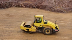 Roadroller compacting the ground Stock Footage