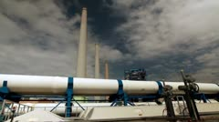 A white pipeline and smokestacks in Israel. Stock Footage