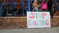 Students With Anti-Bullying Sign At School Stock Footage