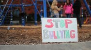 Stock Video Footage of Students With Anti-Bullying Sign At School
