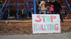 Frightened Girl With Stop Bullying Sign At School Stock Footage