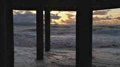 Alaskan Storms - Roiling Breakers Storm Surge Under Pilings Sunset Stock Footage