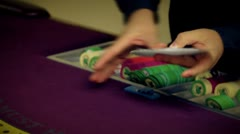 Slow motion clip of card shuffling trick. - stock footage