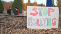 Students Bullying Another Student On School Yard - stock footage