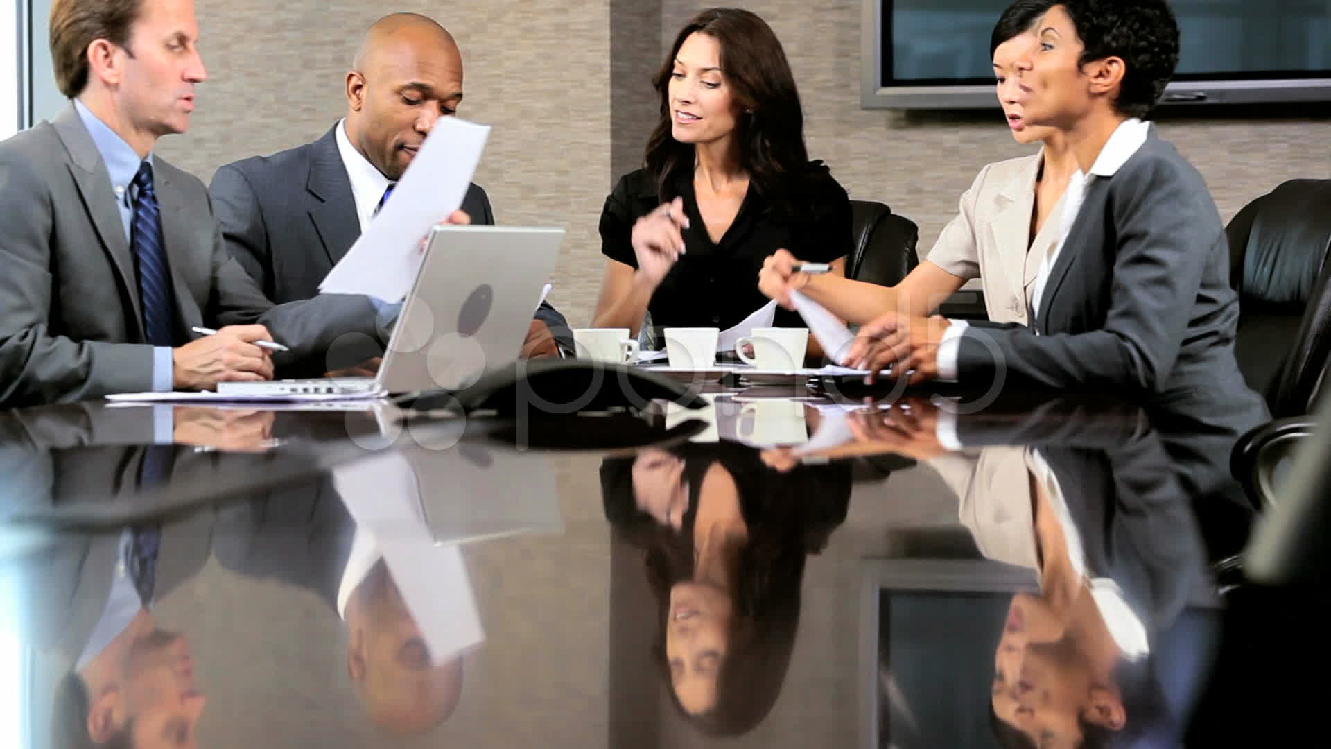 Multi Ethnic Business Group In Boardroom Meeting