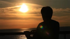 Man on the background of a sunset at sea Stock Footage