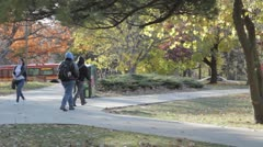 Stock Footage College Students in Fall - Walking, bus, bicycle - stock footage