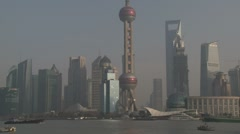 Shanghai Pudong Grand Skyline As Boats Sail Past - stock footage
