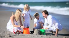 Caucasian Family Building Sand Castles - stock footage