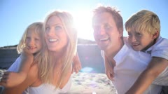 Happy Family Together on the Beach Stock Footage