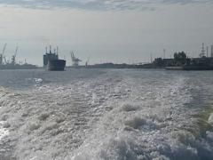Water waves are formed after motor ship. Craft port. Stock Footage