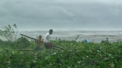 People Desperately Rescue Housing Materials From Rough Waters Stock Footage