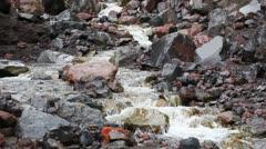 Mountain river flowing through volcanic rocks on Tungurahua, Ecuador Stock Footage