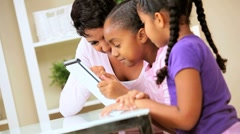 African American Mother and Daughters with Wireless Tablet - stock footage