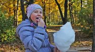 Girl Picks Off Pieces Cotton Candy Stock Footage