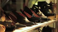 Stock Video Footage of Woman Shopping for High Heel Shoes in Mall