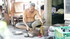 Shaping of alms bowl in Bangkok, Thailand Stock Footage