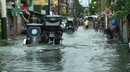 Stock Video Footage of Motorbikes Drive Through Flooded Manila Streets