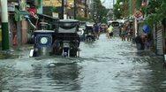 Motorbikes Drive Through Flooded Manila Streets Stock Footage