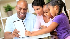 Young Ethnic Family Using Wireless Tablet - stock footage