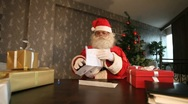 Stock Video Footage of Santa reading letter